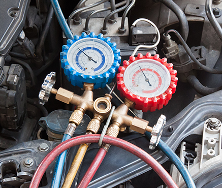 Auto & Truck Mechanic at Avery Automotive Repair repairing air conditioning